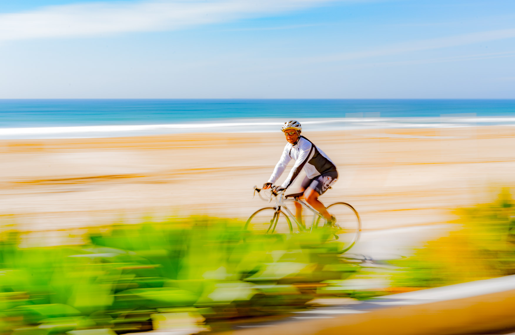 man bike blur beach